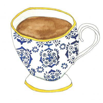 A blue and yellow patterned mug